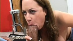 Enticing brunette has two massive black cocks stretching her peach