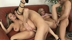 Two stacked blonde hotties getting roughly double drilled on the couch