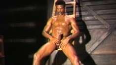 Muscled black dude is in the basement jerking off his throbbing cock
