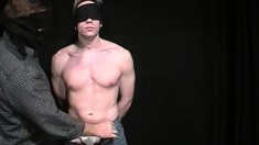 Muscular blonde jock gets blindfolded for his anal initiation